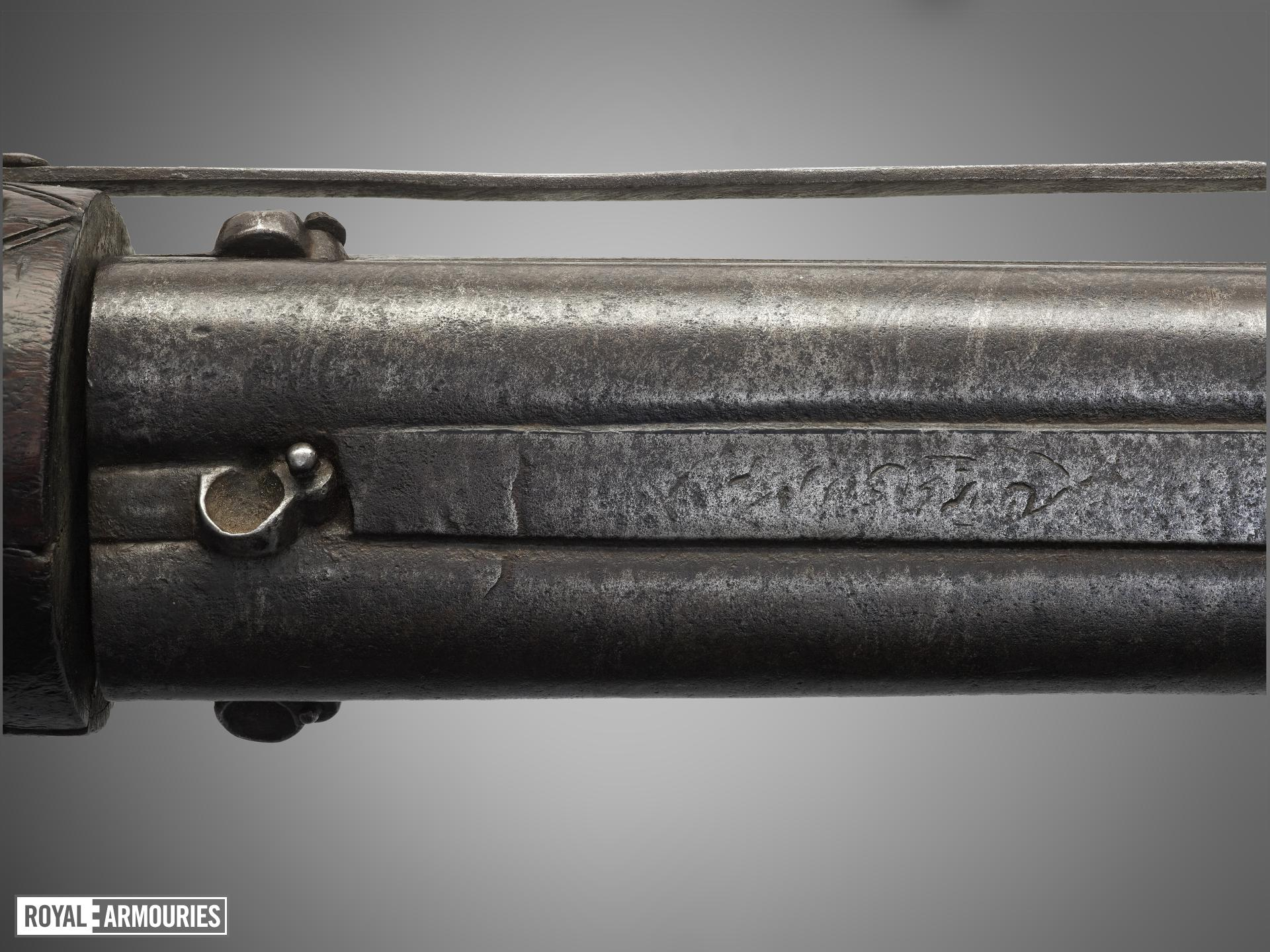 Matchlock revolver gun with rounded butt