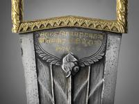 Thumbnail image of Dagger and scabbard (katar) with inscrption and elephant's head.