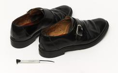 Thumbnail image of Shoe With concealed knife A standard shoe with a cavity made in the heel to house a short knife