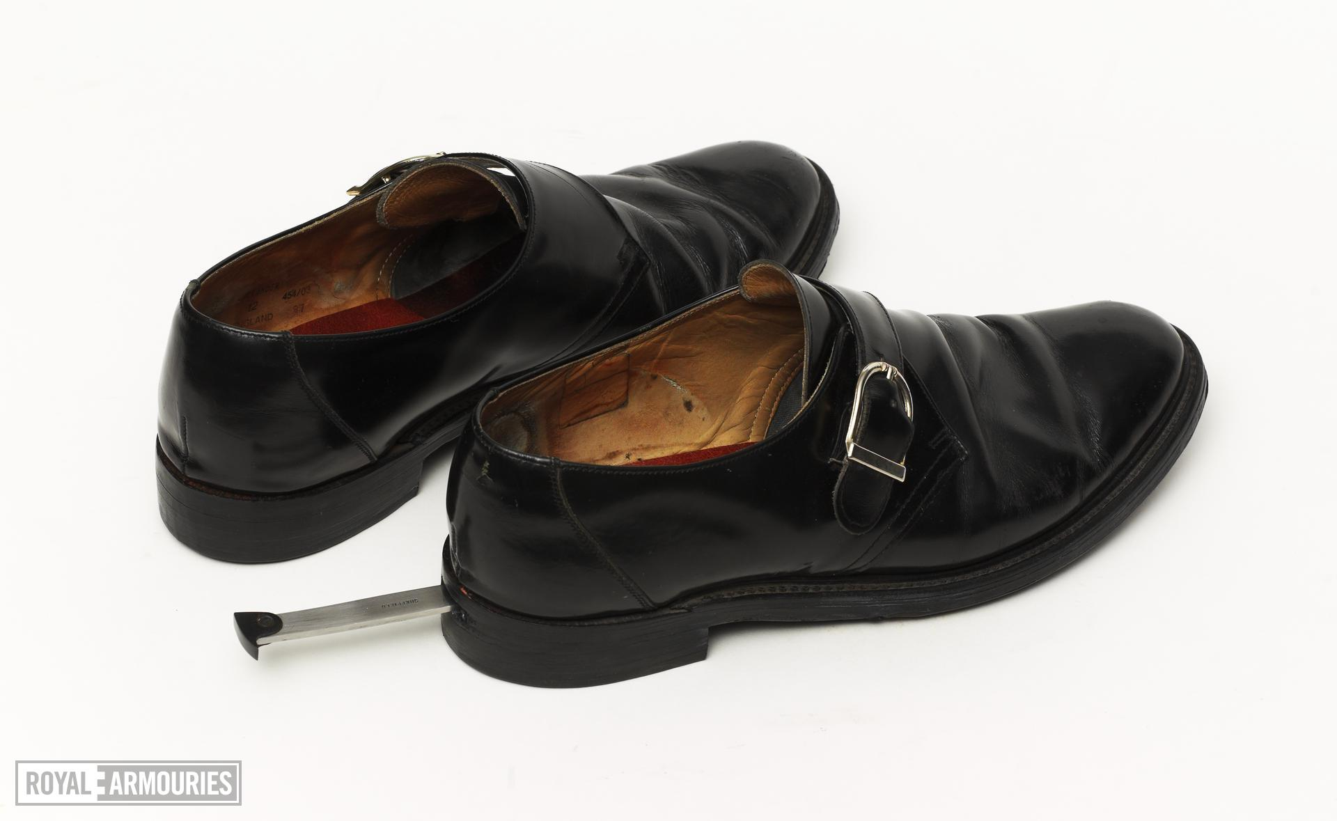 Shoe With concealed knife A standard shoe with a cavity made in the heel to house a short knife