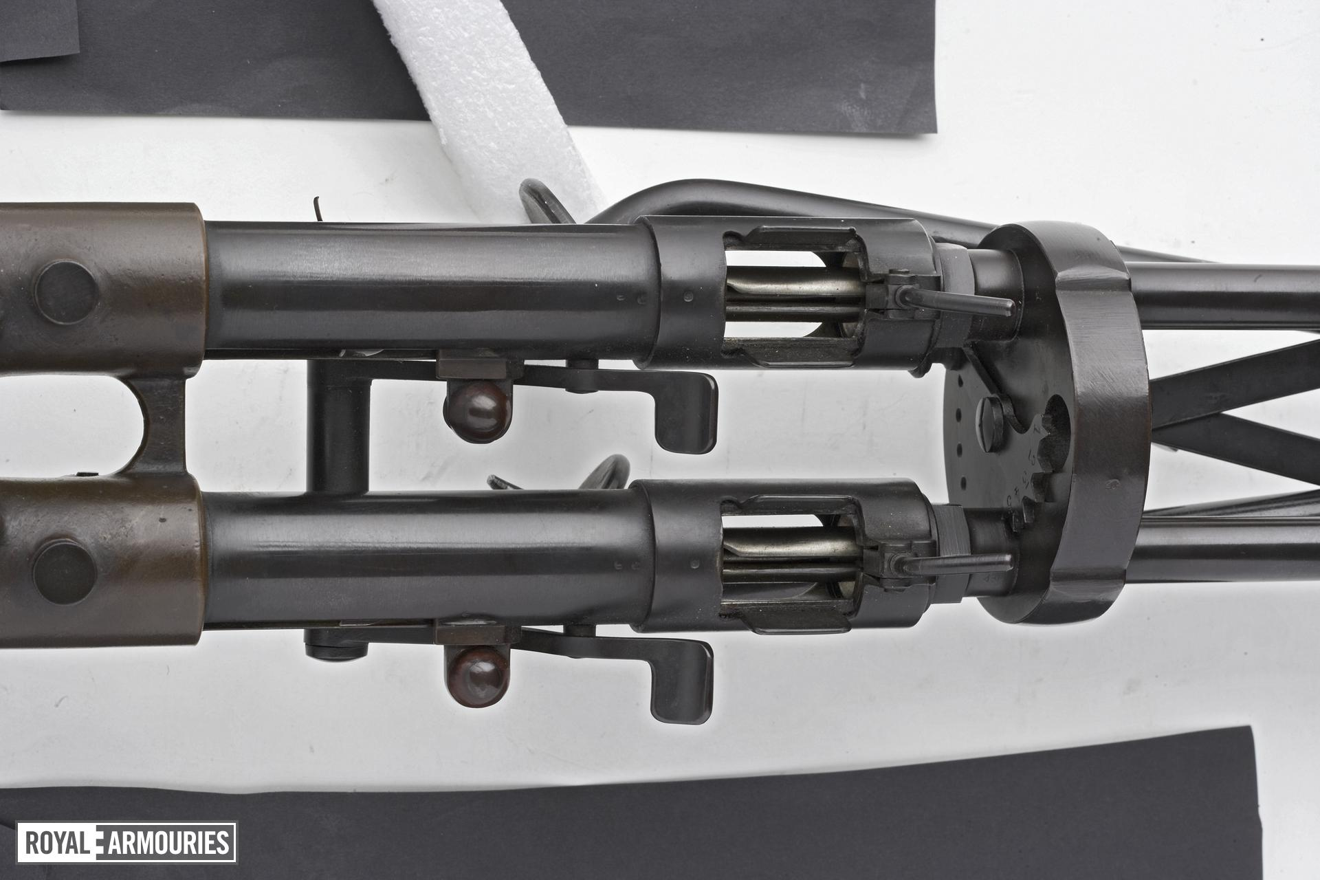 Twin Villar Perosa delayed blowback operated double barrelled submachine gun, various manufacturers in Italy and Canada