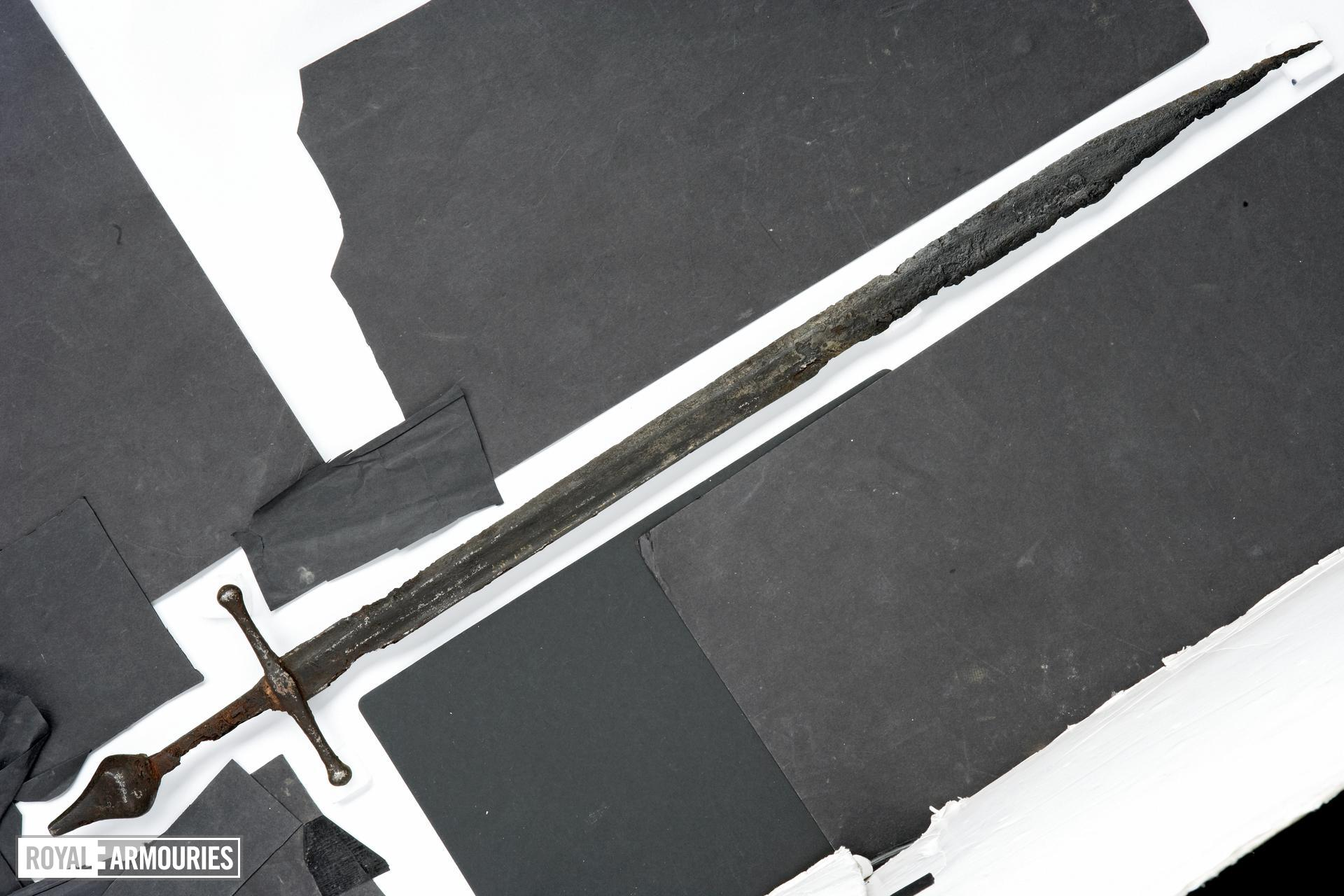 Sword Cross-hilted sword, with falchion-like blade
