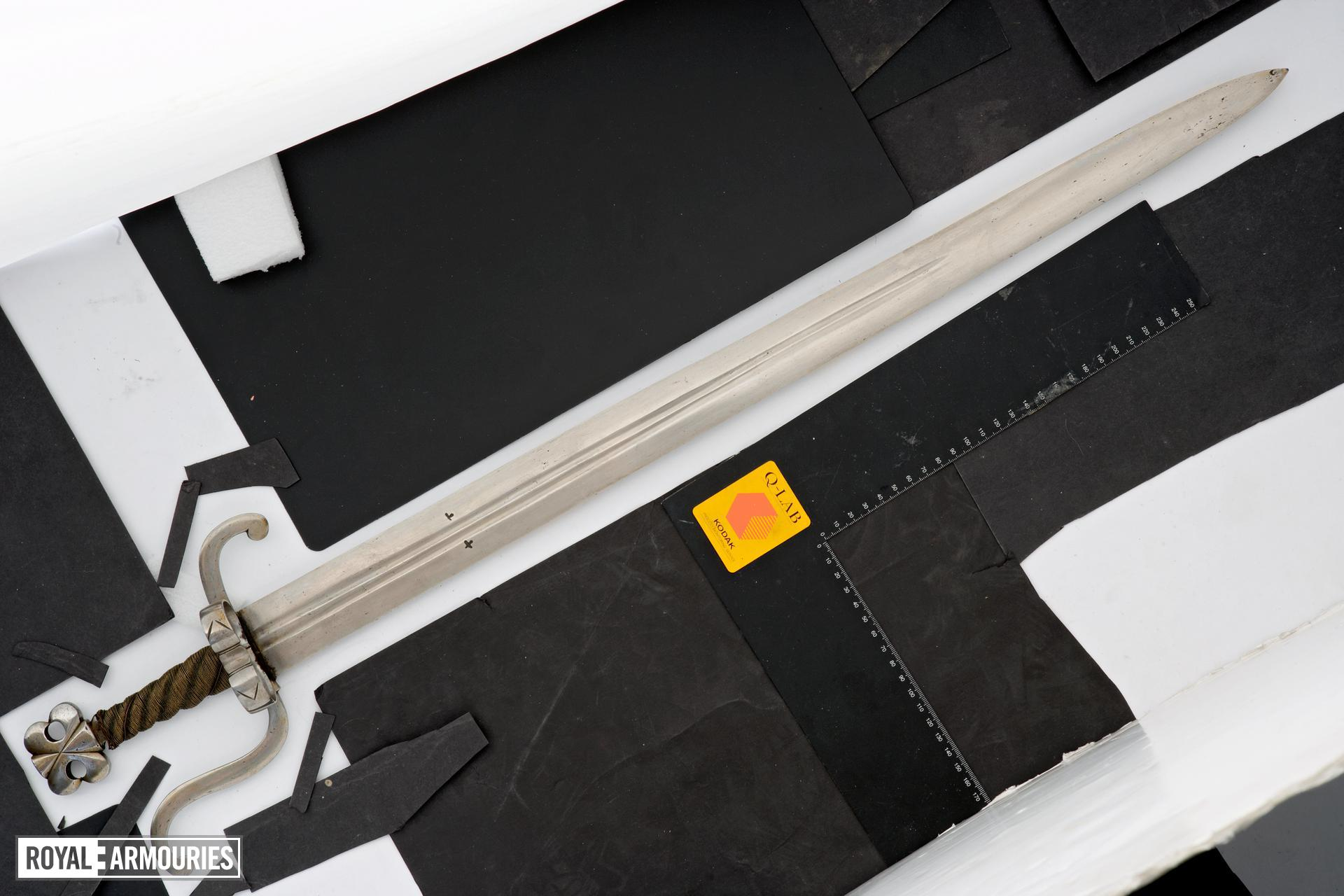 Sword with counter-curved quillons.