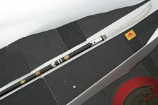 Thumbnail image of Naginata with black lacquered shaft.