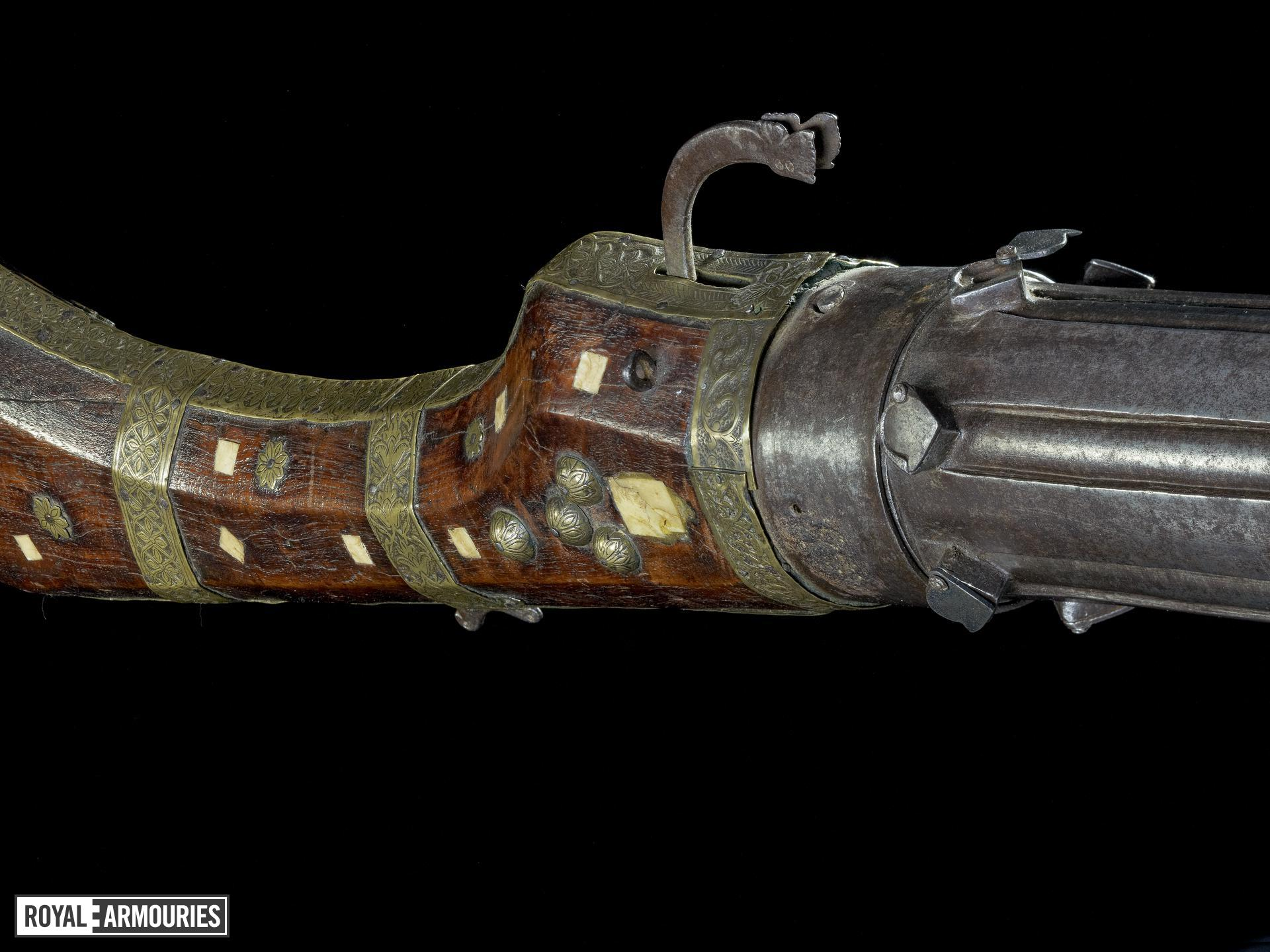 Matchlock revolver gun With shield to cylinder