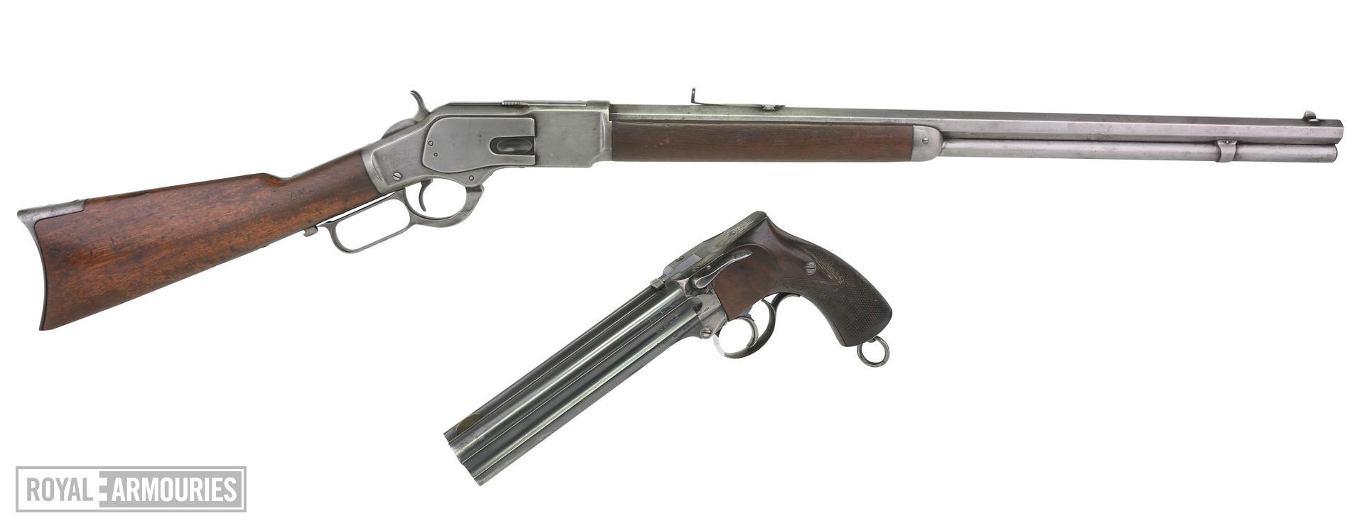 Centrefire lever-action magazine rifle. Winchester Model 1873. Carried by Arthur Mounteney-Jephson on the Emin Pasha relief expedition of 1890. XII.1140. Alongside Centrefire four-barrelled pistol,Large Frame Holster Model, British, about 1881, Thorn patent by Charles Lancaster XII.3523