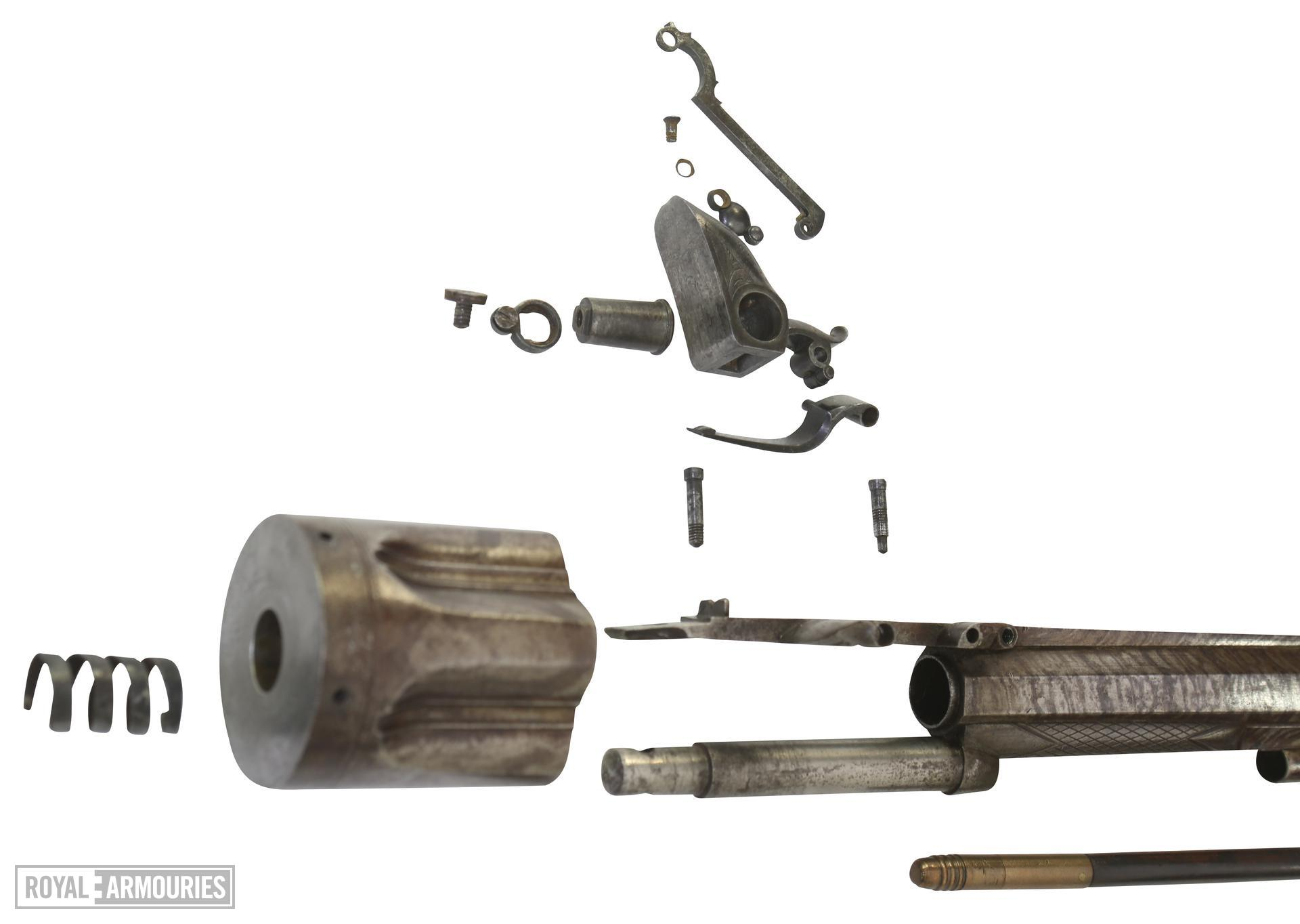 Flintlock six-shot revolver by Collier. A revolving cylinder pistol that requires the cylinder to be manually turned. It has an octagonal barrel, with single pipe for a wooden cleaning rod. The cylinder is six-shot, and has a frizzen mounted to the right of the barrel, as would normally be found on a standard flintlock pistol. The rotation of the cylinder permits the touch-hole to line up with the frizzen. There is a sliding cover over the touch hole. The trigger guard is squared at the rear, and the butt is fully chequered. The lockplate, tang and top of the barrel are foliate engraved, with the Union Jack and Stand of Arms also incorporated. XII.4000