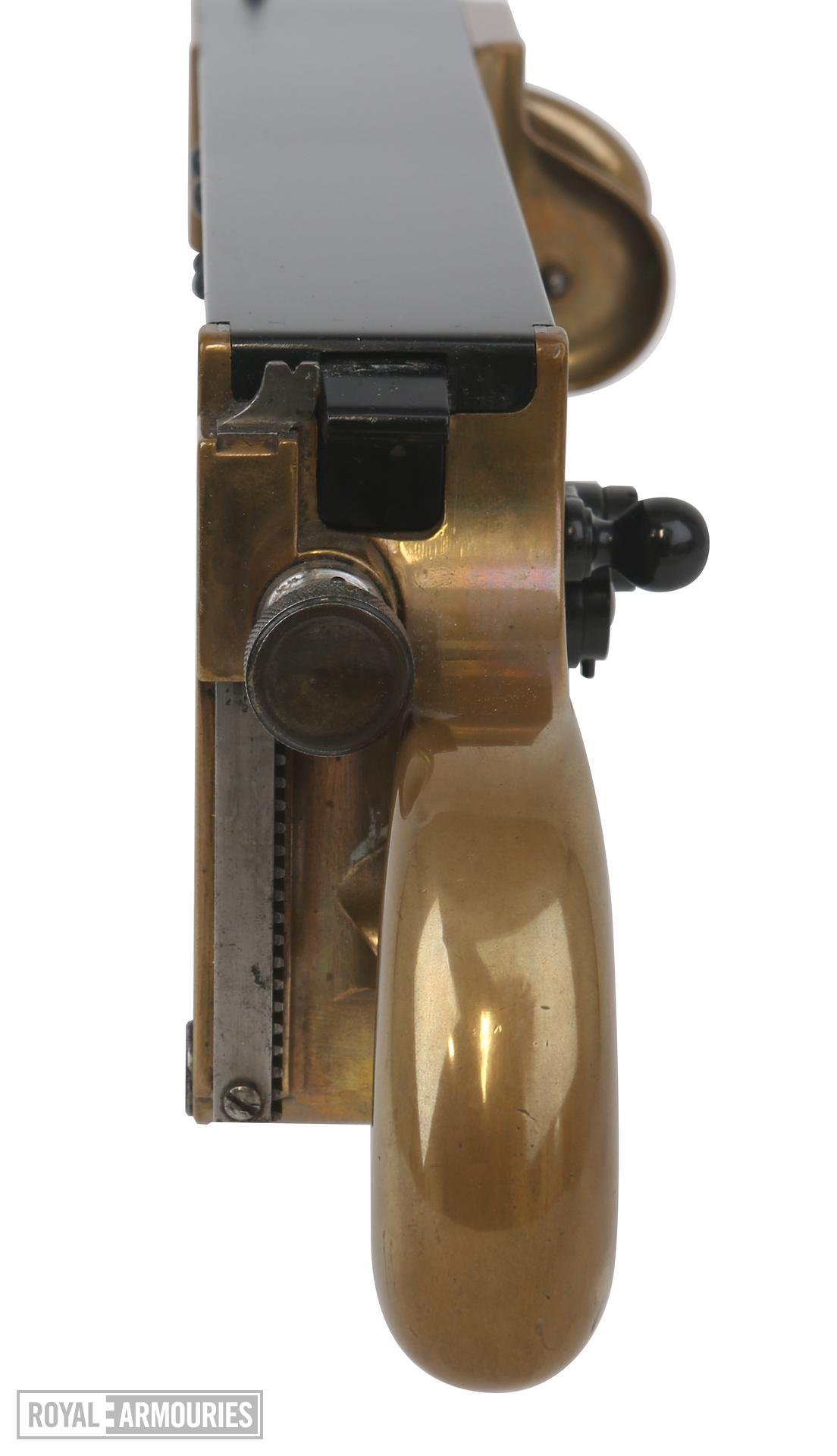 Miniature Maxim gun. Hiram Maxim was the first to engineer a gun that could fire continuously as long as its trigger was pulled. This reduced-scale gun was used to demonstrate the recoil operated mechanism. Because it fires the Mauser pistol cartridge, it is also technically the world's first submachine gun. PR.7163