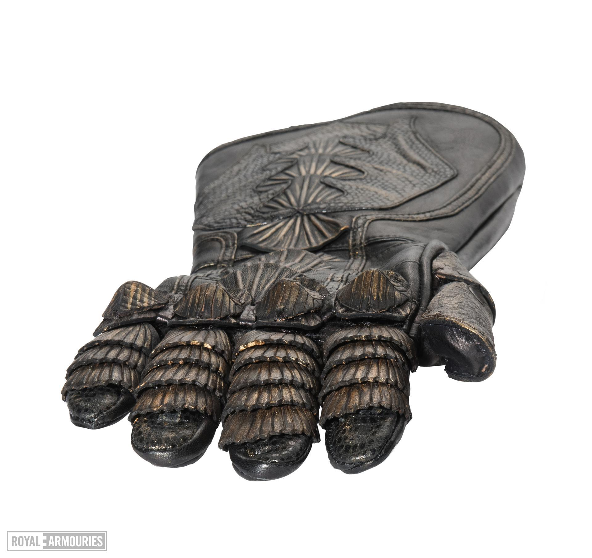 Right glove - Right glove from The Lord Marshal's Costume Part of the Lord Marshal's costume from the film the Chronicles of Riddick. Ornately decorated and highly detailed. Bronze and black in appearance but made from leather.
