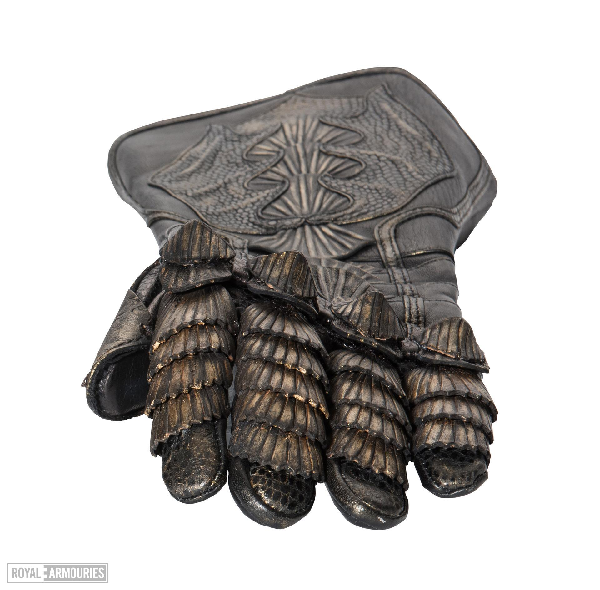 Left Glove - Left glove from The Lord Marshal's Costume Part of the Lord Marshal's costume from the film the Chronicles of Riddick. Ornately decorated and highly detailed. Bronze and black in appearance but made from leather.