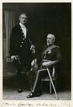 Thumbnail image of Charles ffoulkes (standing), Curator of the Armouries at the Tower of London, with his predecessor Viscount Lord Dillon in 1913.