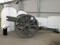 Thumbnail image of 77mm Rifled breech-loading field gun and carriage, German, 1915. Model of 1896, new pattern; carriage original.