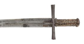 Thumbnail image of Sword (kaskara) with crocodile skin hilt and a scabbard covered in snake or lizard skin. Sudan, 19th century. XXVIS.63