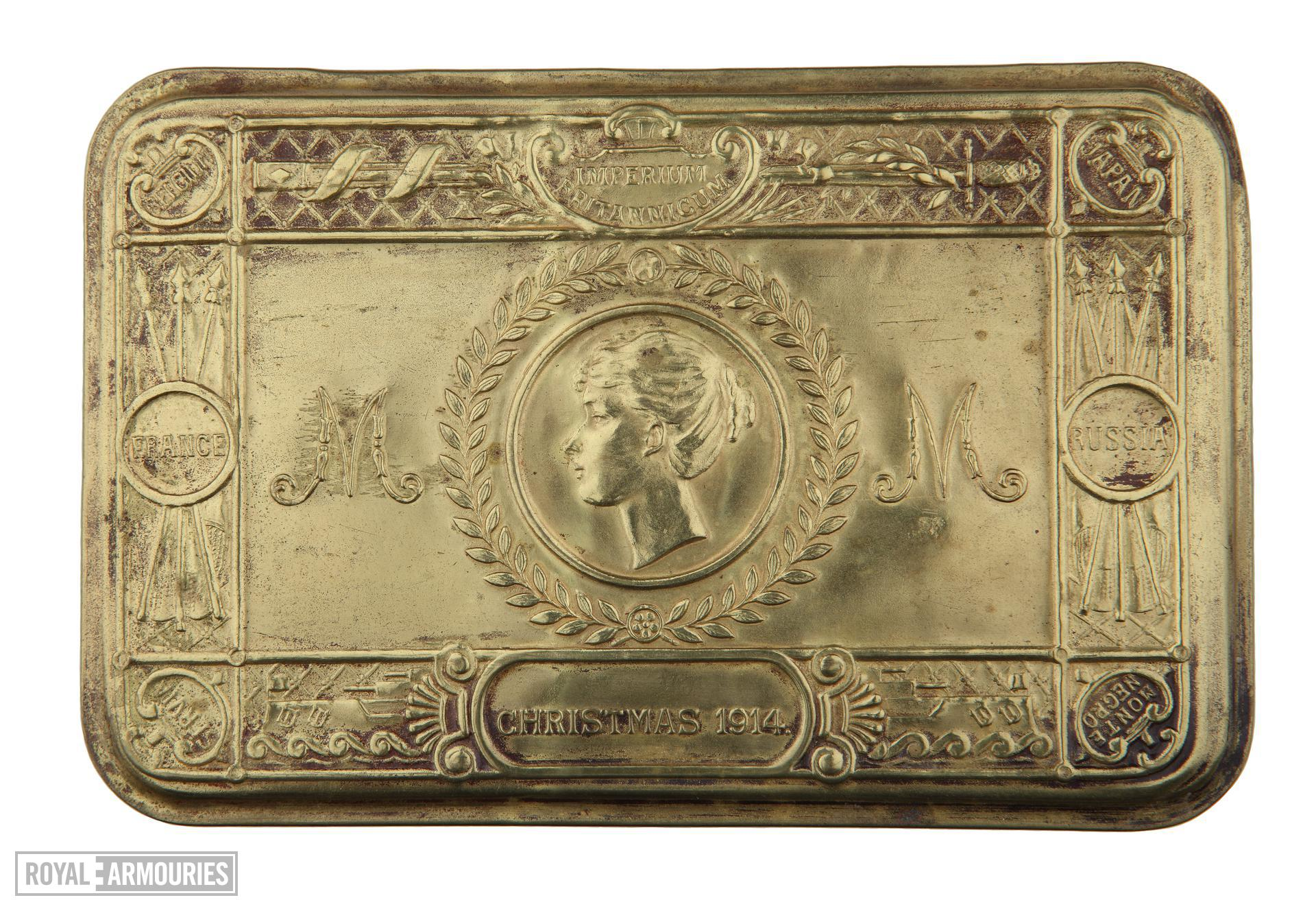 Queen Mary's Christmas Box. Small tin filled with sweets and tobacco, issued to British servicemen at Christmas 1914. This tin was issued to  Lance Sergeant Thomas Queenan, 1st West Yorkshie Regiment.