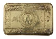 Thumbnail image of Queen Mary's Christmas Box. Small tin filled with sweets and tobacco, issued to British servicemen at Christmas 1914. This tin was issued to  Lance Sergeant Thomas Queenan, 1st West Yorkshie Regiment.