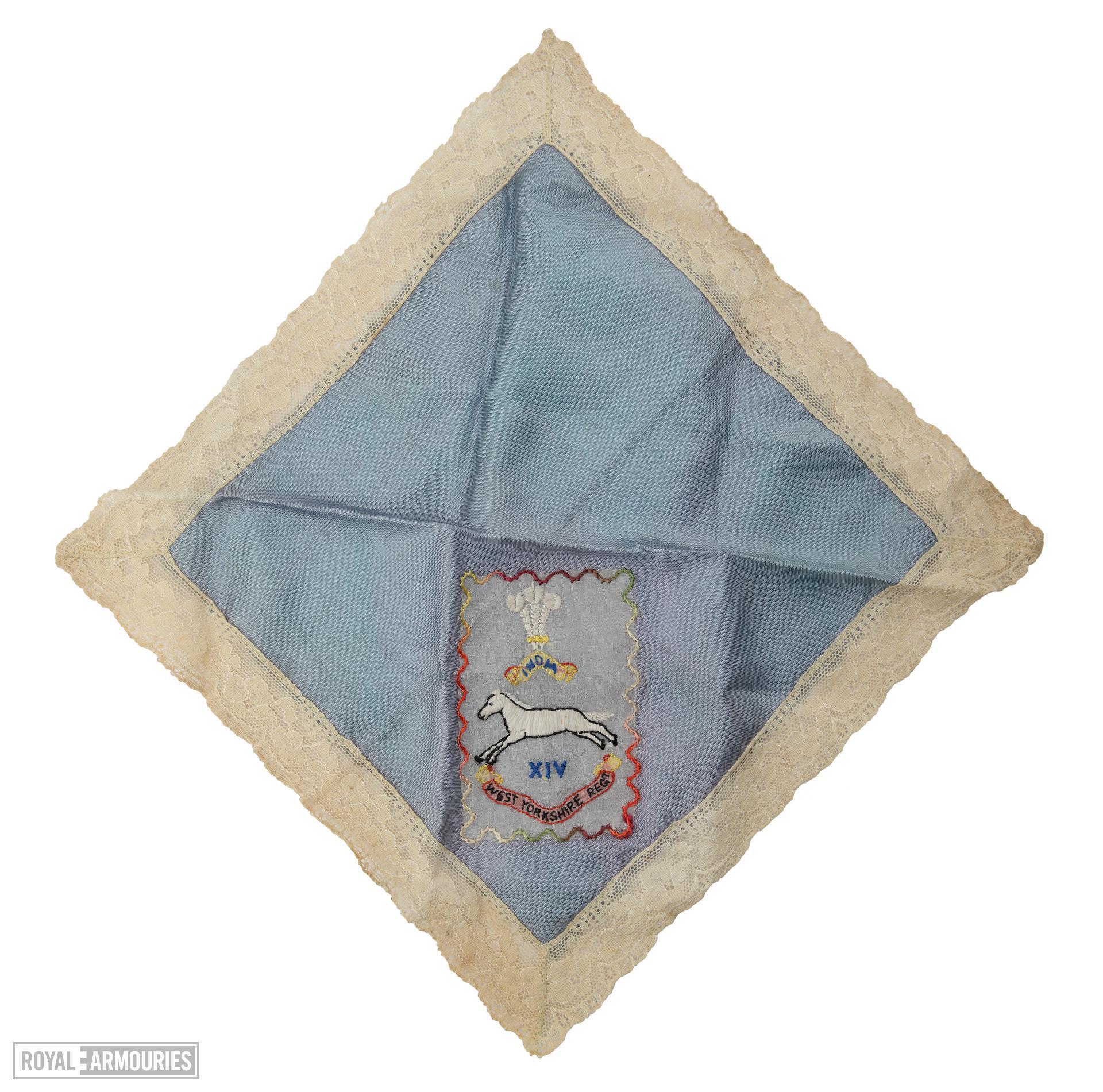 Regimental souvenir silk handkerchief, bearing the badge of the 1st West Yorkshire Regiment.  (XVIII.461)