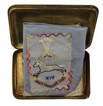 Thumbnail image of Regimental souvenir silk handkerchief, bearing the badge of the 1st West Yorkshire Regiment.  (XVIII.461)