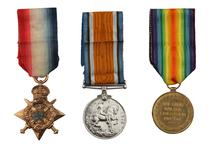 """Thumbnail image of 1914 Star Medal Trio, consisting of 1914 Star (""""Pip""""), British War Medal (""""Squeak"""") and Victory Medal (""""Wilfred""""). This trio  issued to  Lance Sergeant Thomas Queenan, 1st West Yorkshie Regiment."""