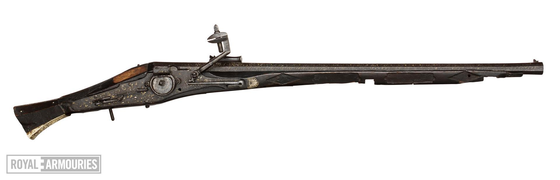 Wheellock pistol. Probably Dutch, about 1550. Possibly decorated by Damianus de Nerve or Diego de Caias (XII.10250)