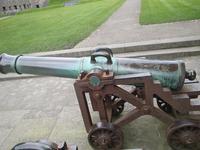 Thumbnail image of The gun on display at Caernarfon Castle.