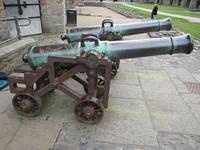Thumbnail image of The gun on display at Caernarfon Castle, with its pair XIX.858.